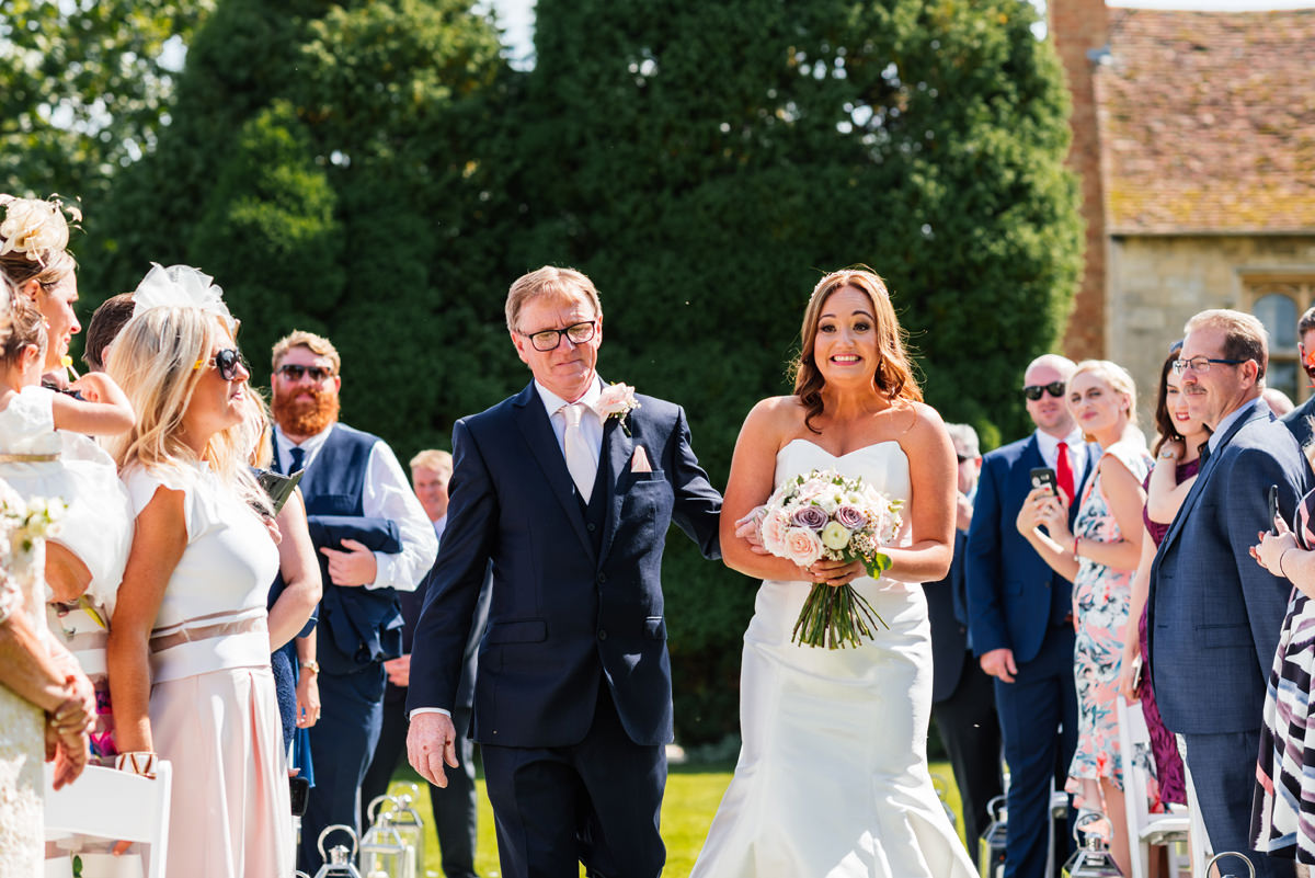father of the bride and bride arrives for marriage ceremony