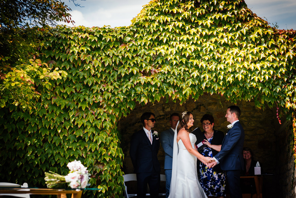 exchanging vows during outdoor ceremony
