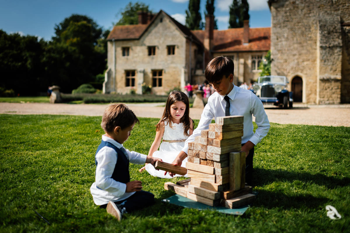children playing with Jenga blocks