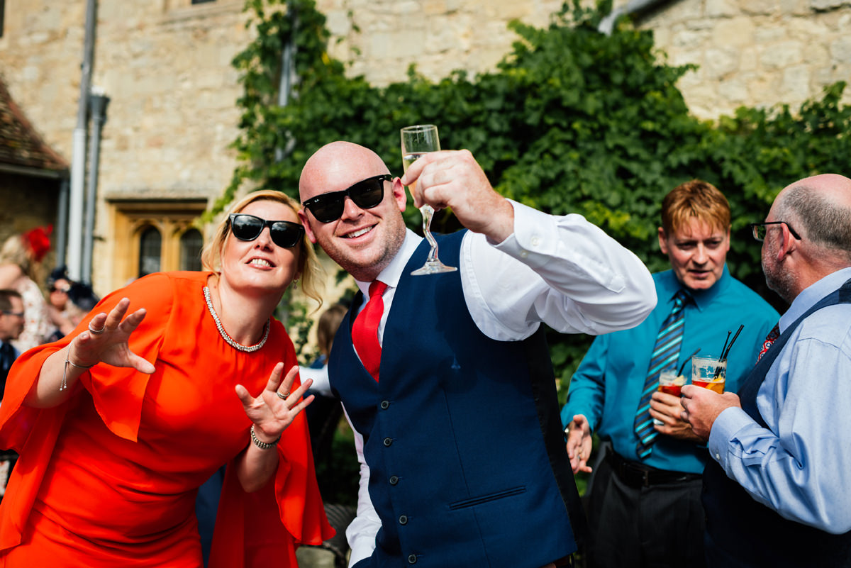 wedding guests having fun during drinks reception