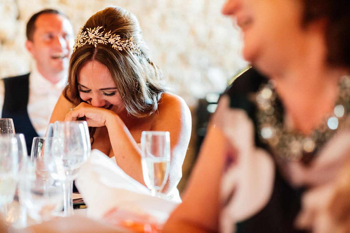 bride laughing at groom's speech