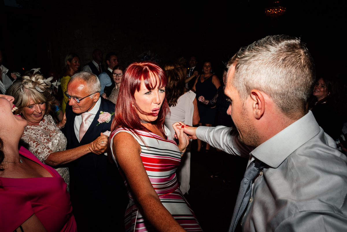 wedding guests throwing shapes on the dance floor
