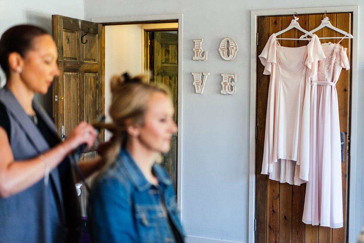 bridesmaids dresses hanging up during bridal prep