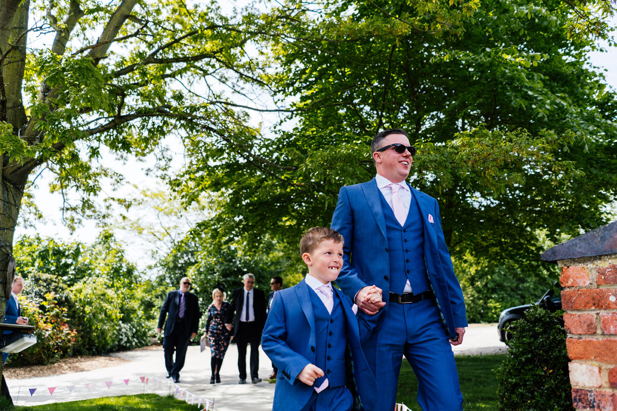 groom arrives with page boy