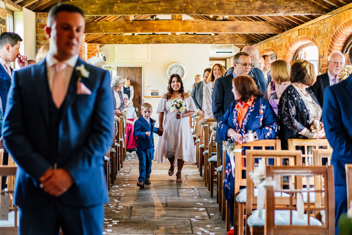 bridesmaid and page boy arrive at ceremony