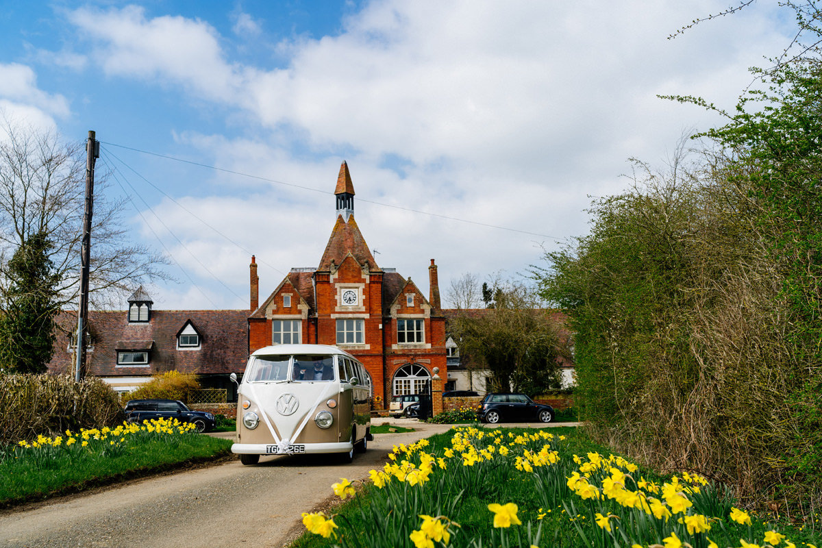 vw camper van leaves b&b with bride and bridemaids