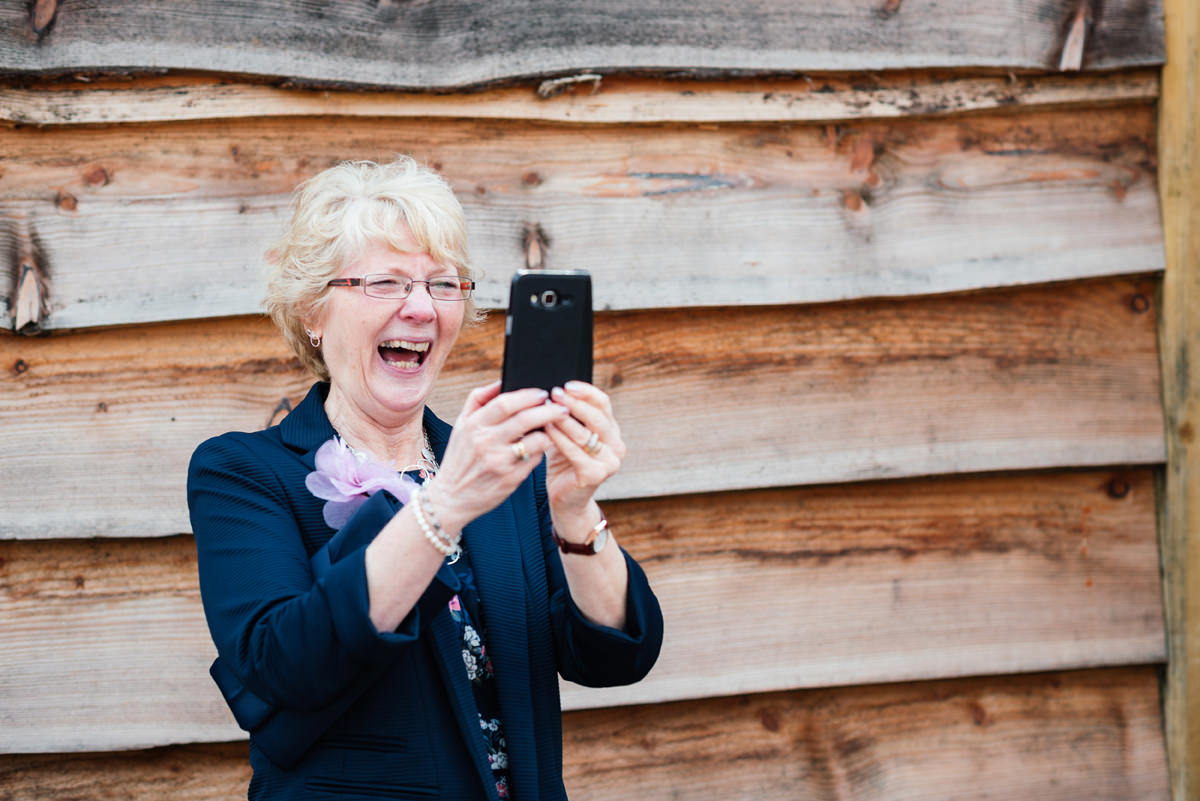 wedding guest taking photo with phone