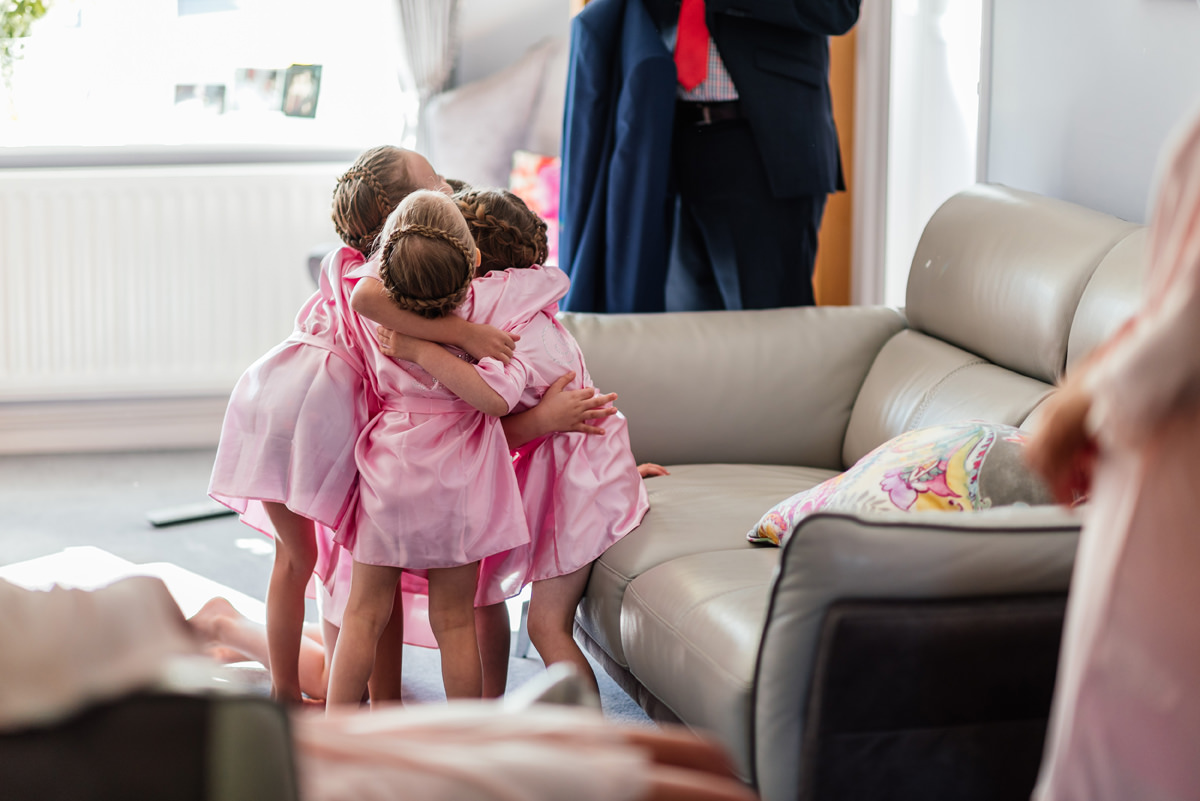 flower girls hugging during bridal prep