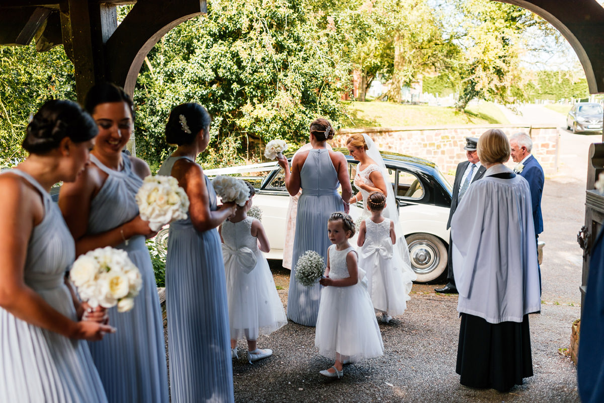 bride arrives at the church with bridesmaids
