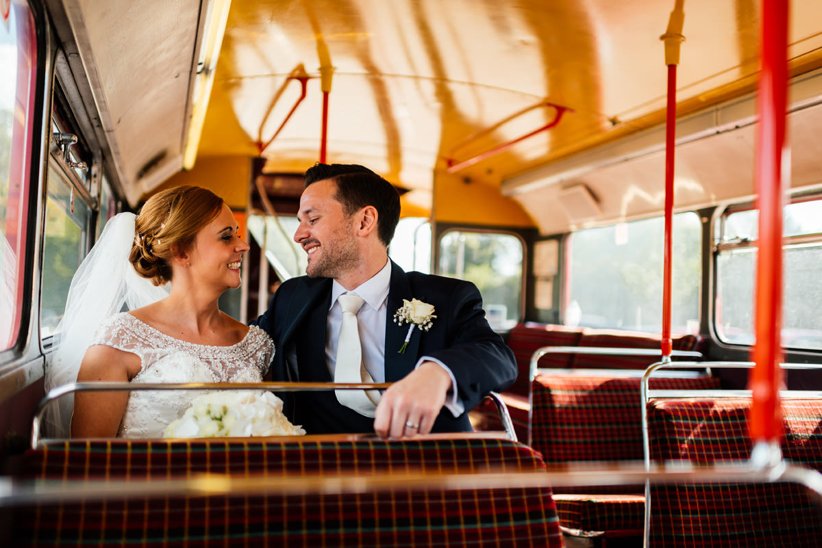 bride and groom on the london bus