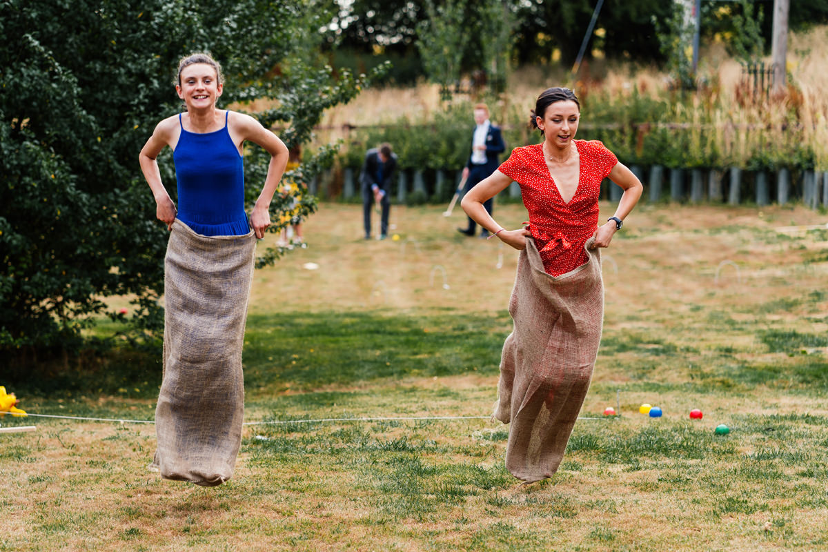 sack race summer games at wedding