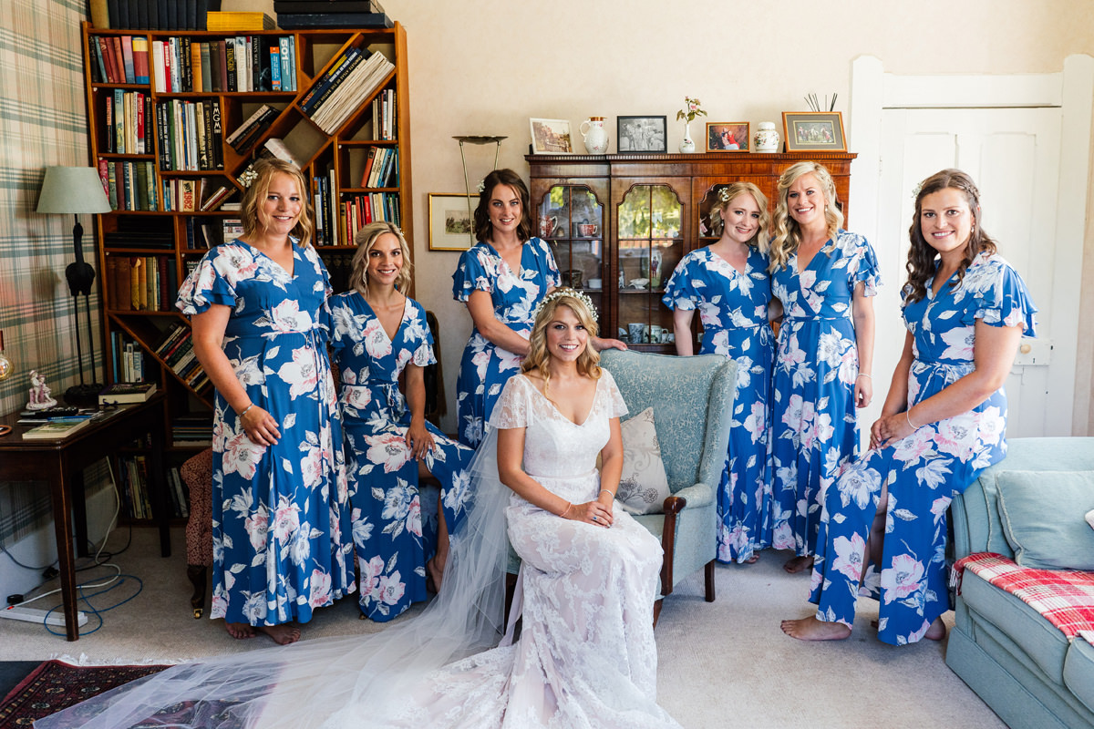 group photo of bridesmaids and bride before they head off to the church