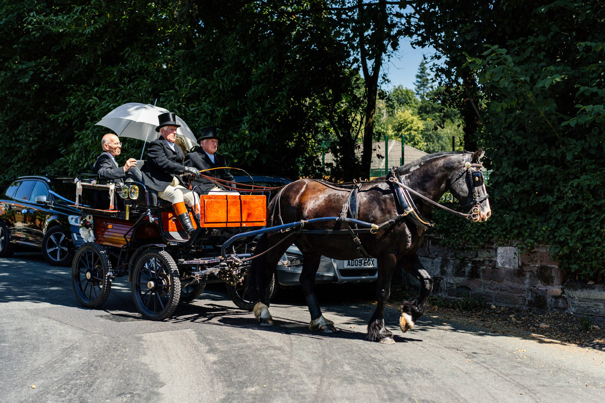 bride arrives at church on horse and carriage