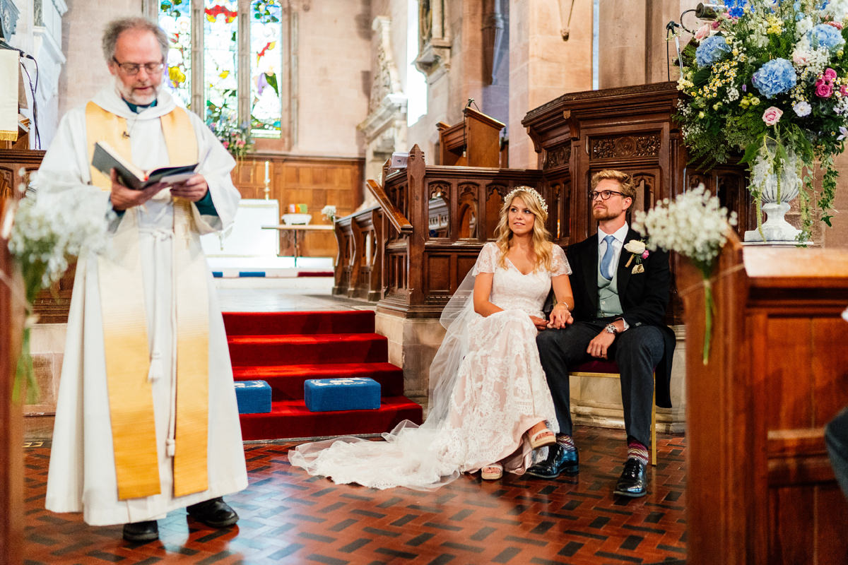 bride and groom listening to the vicar during the ceremony