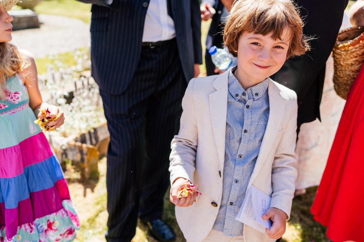 wedding guest getting ready to throw confetti