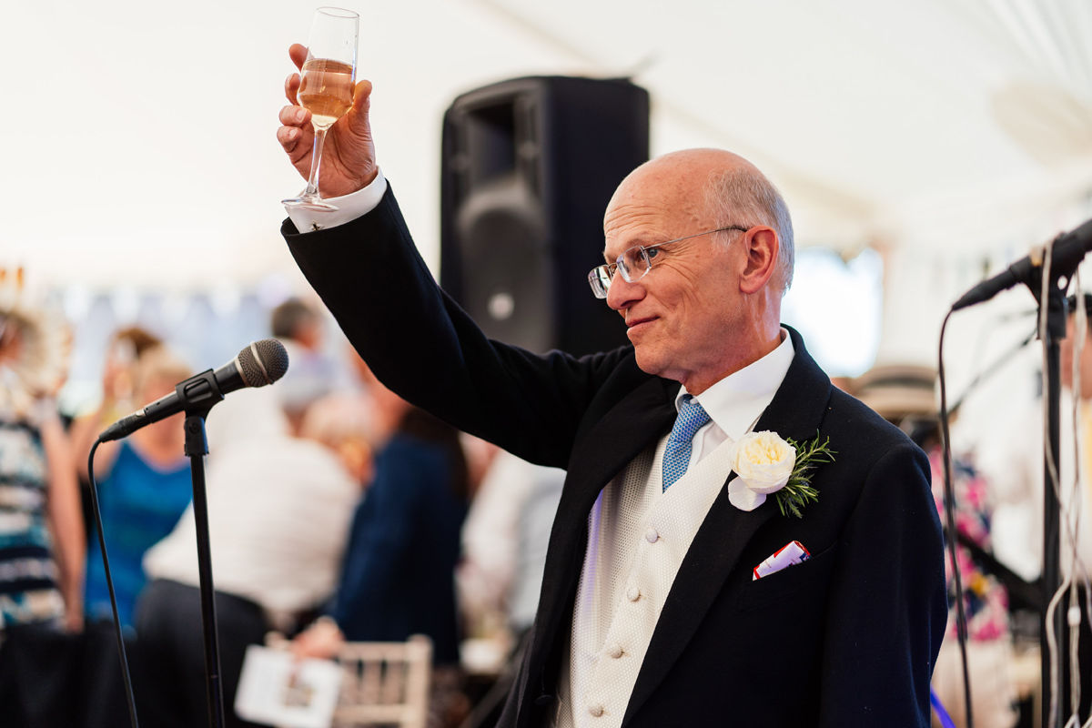 father of the bride toasts the bride during the speeches