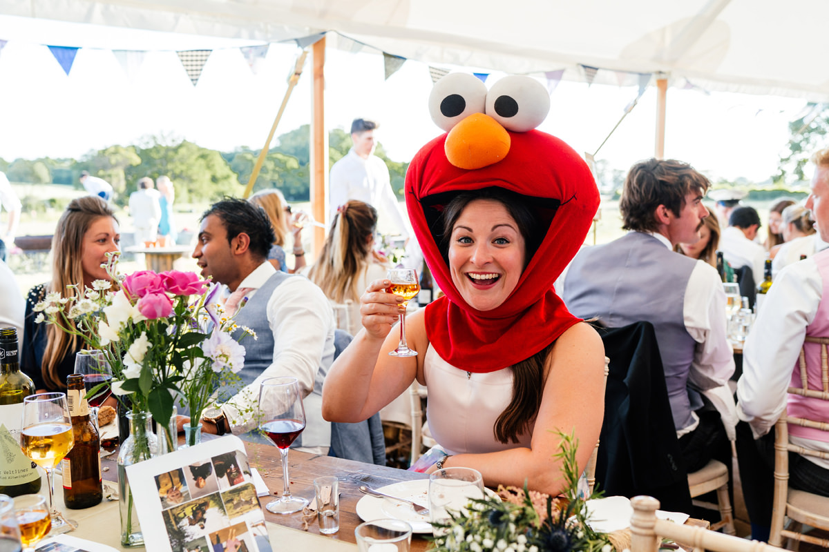 wedding guest wears an Elmo mask