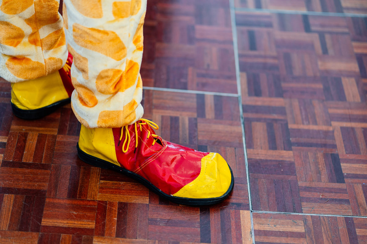 best man wears big clown shoes