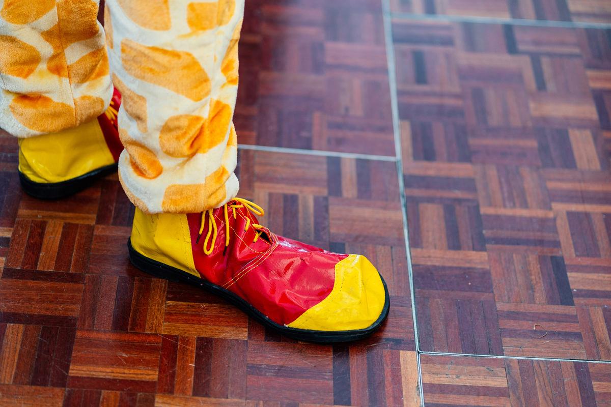 best man wears big clown shoes