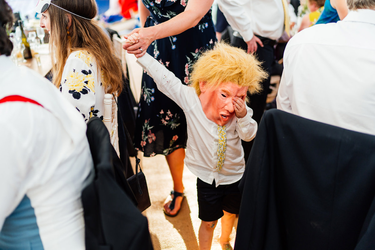 child at wedding wearing a donald trump mask