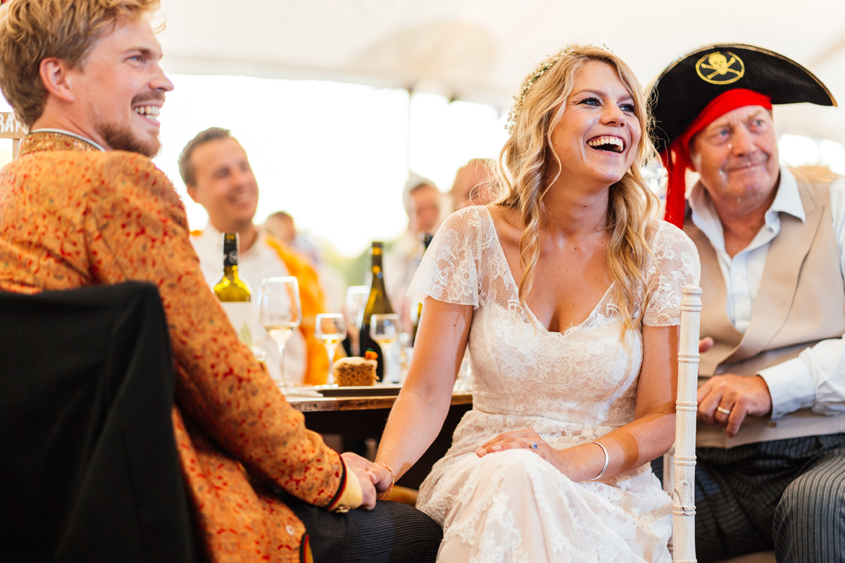 groom and bride listen to best man speech