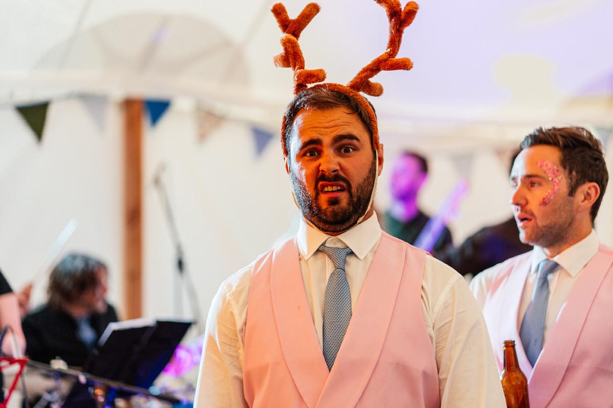 groomsman wearing antlers