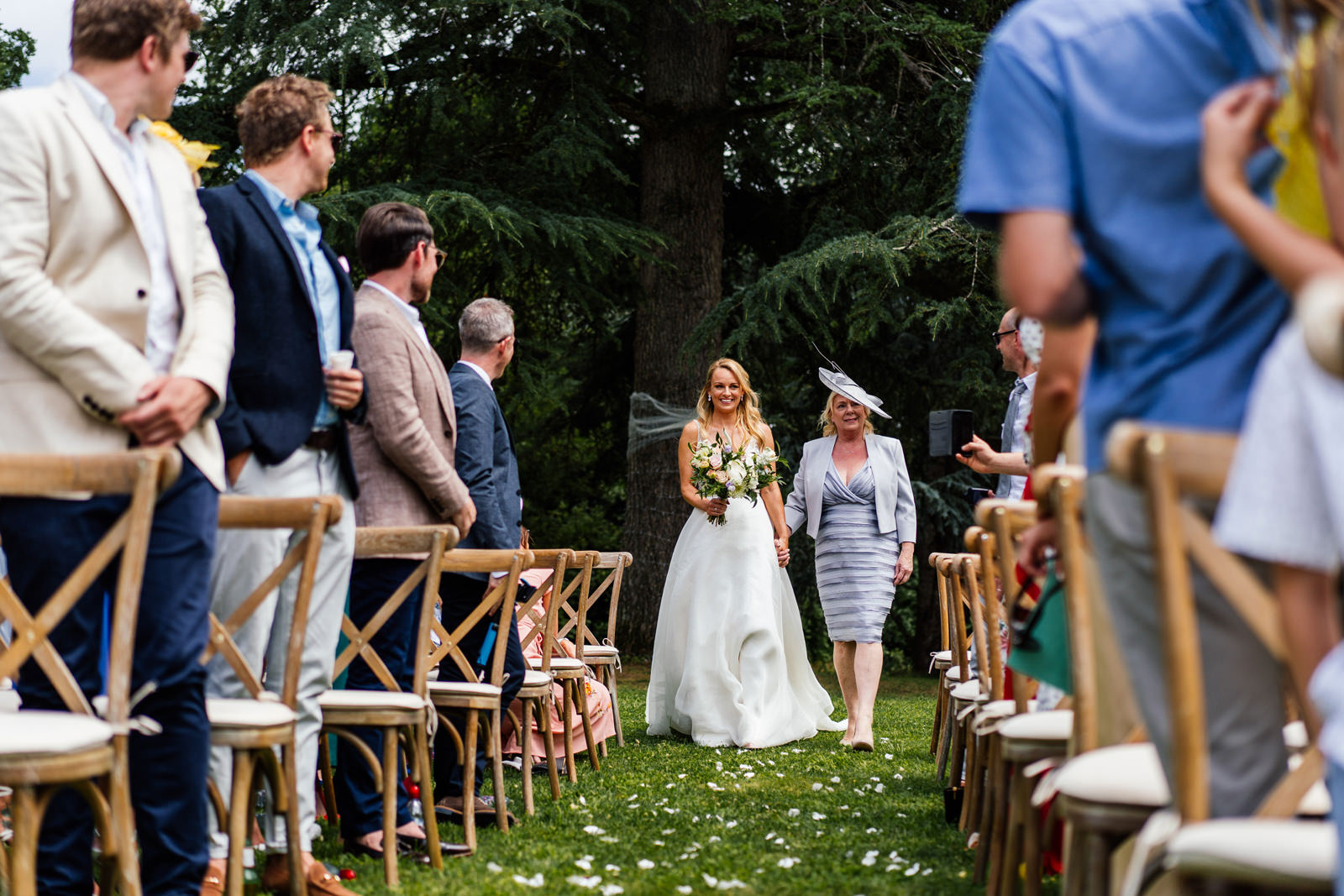 bride walked down the aisle by her mother