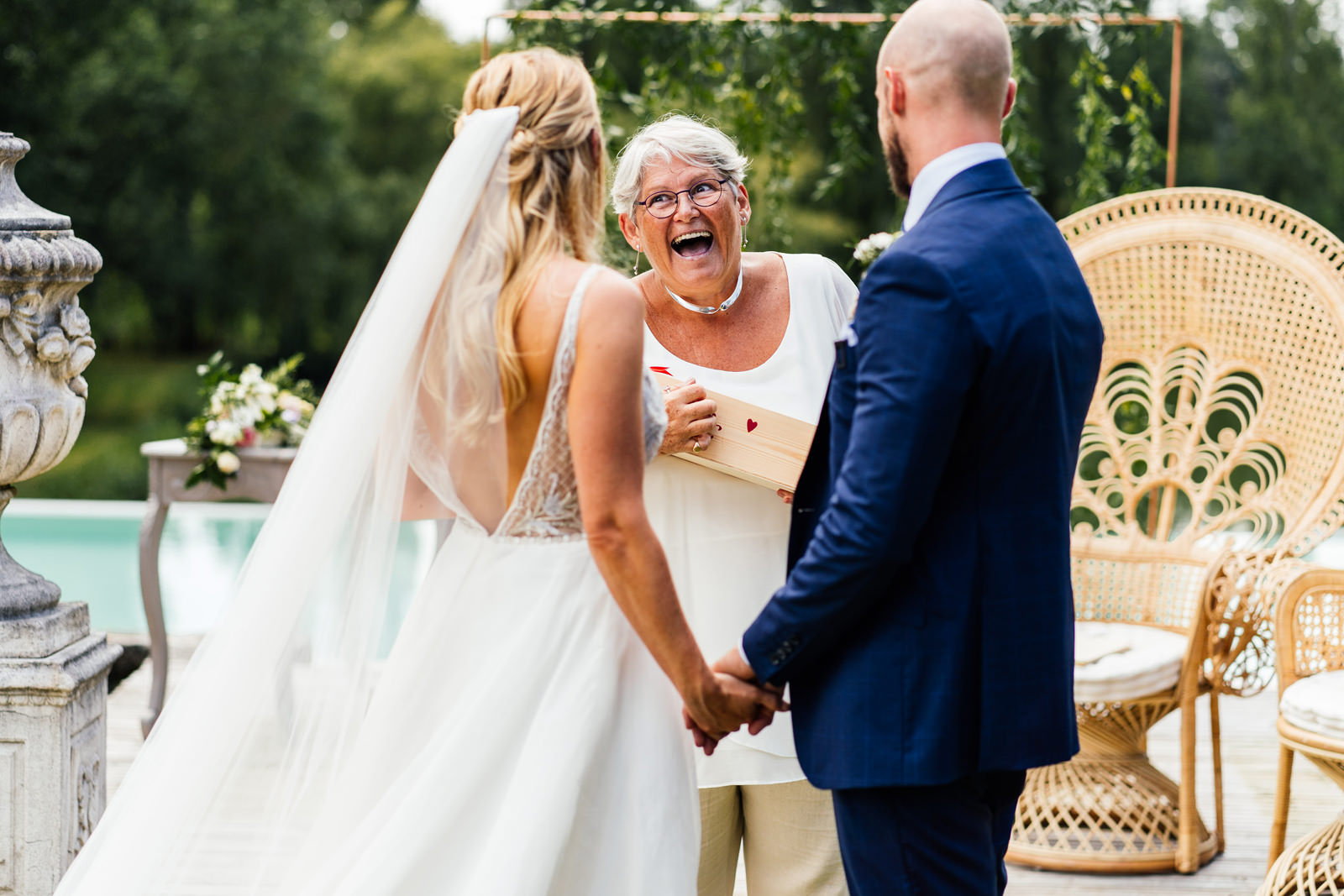 celebrant gives bride and groom a gift