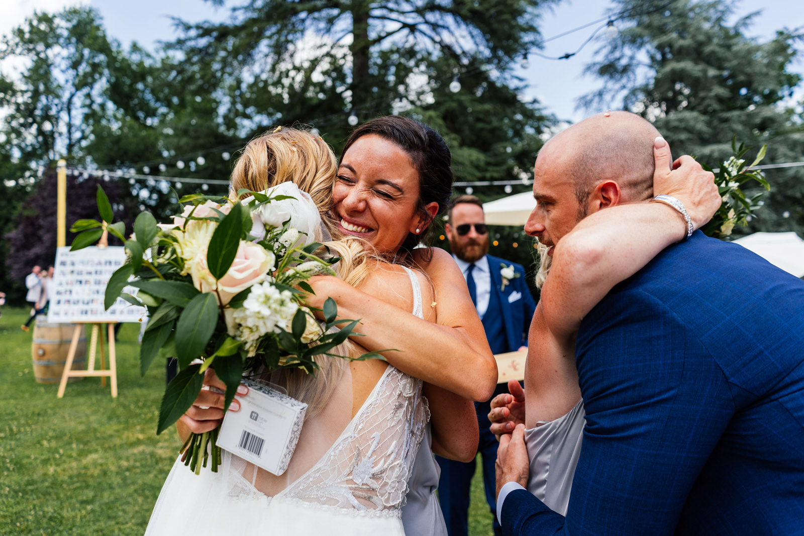 guests congratulate newly married couple