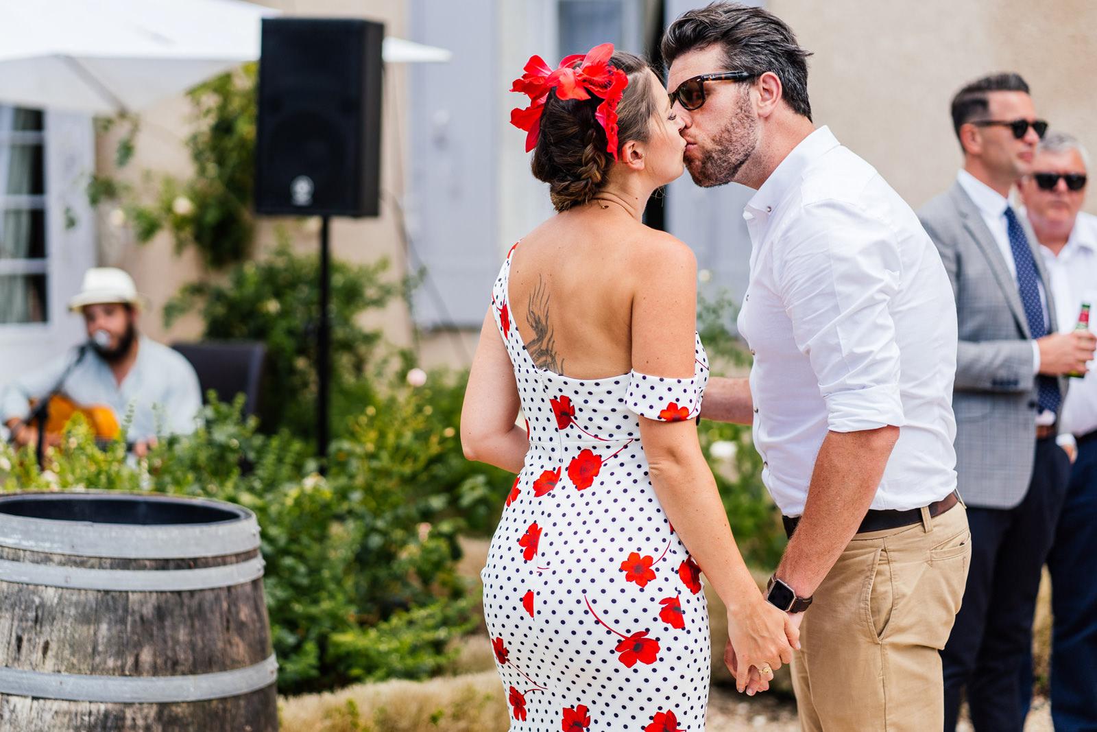 wedding guests having a cheeky little kiss