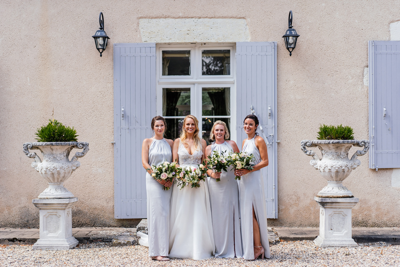 bride and bridesmaids formal group photo