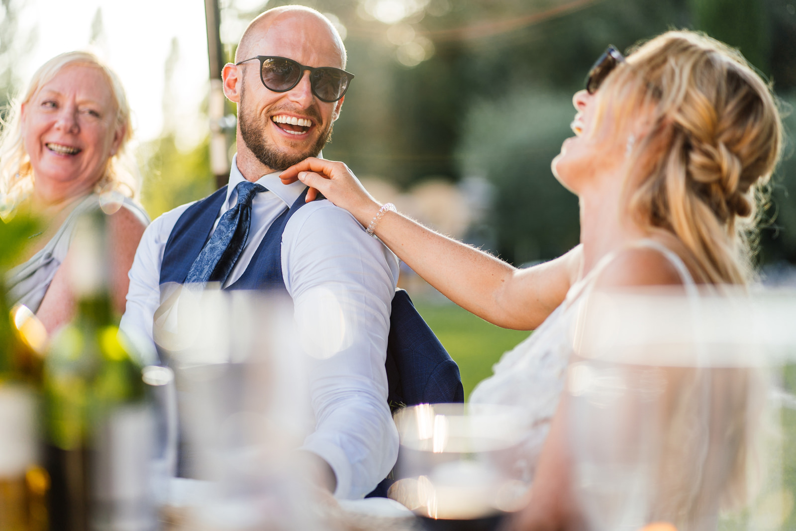 groom smiling at his bride during the speeches