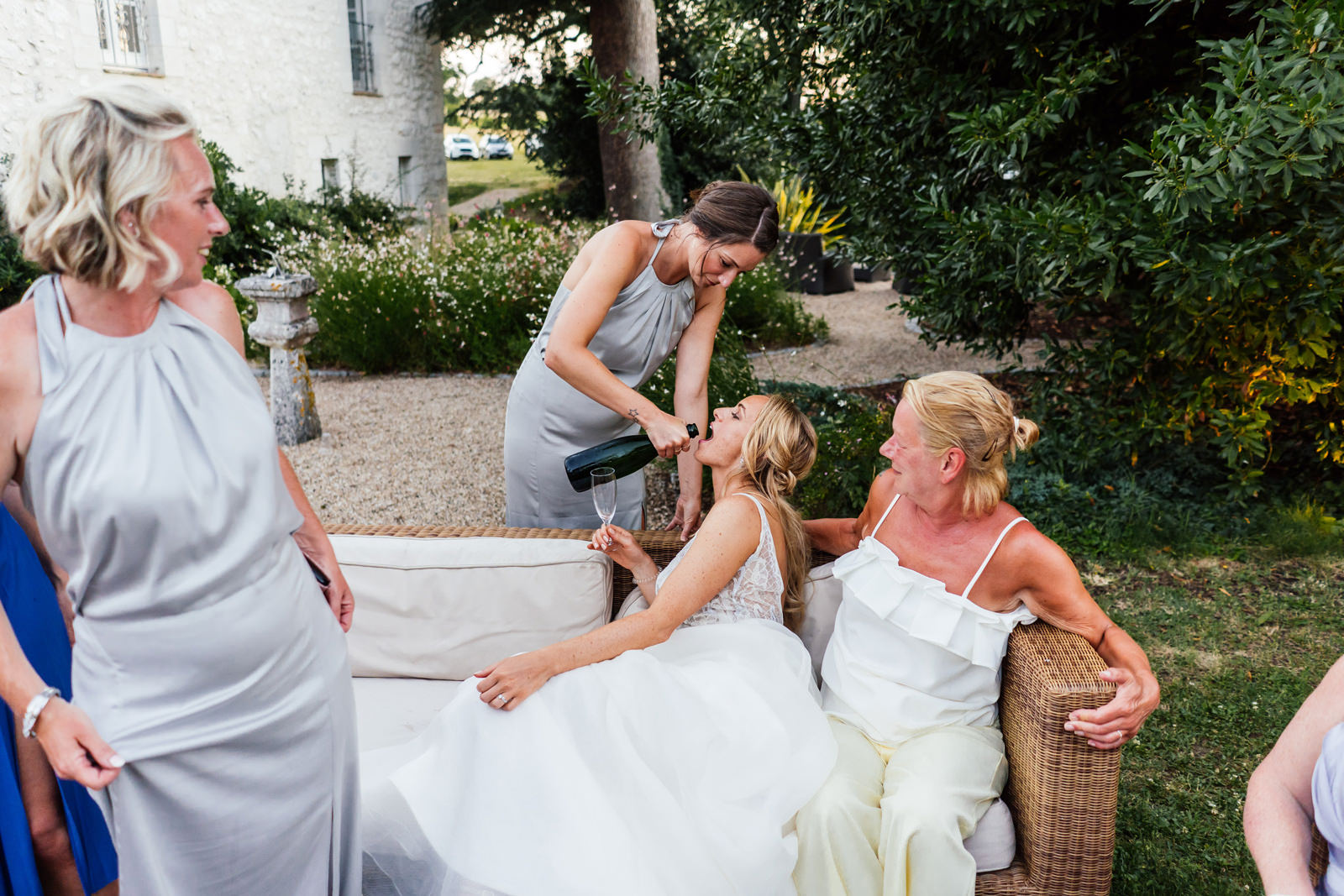 bride being fed champagne