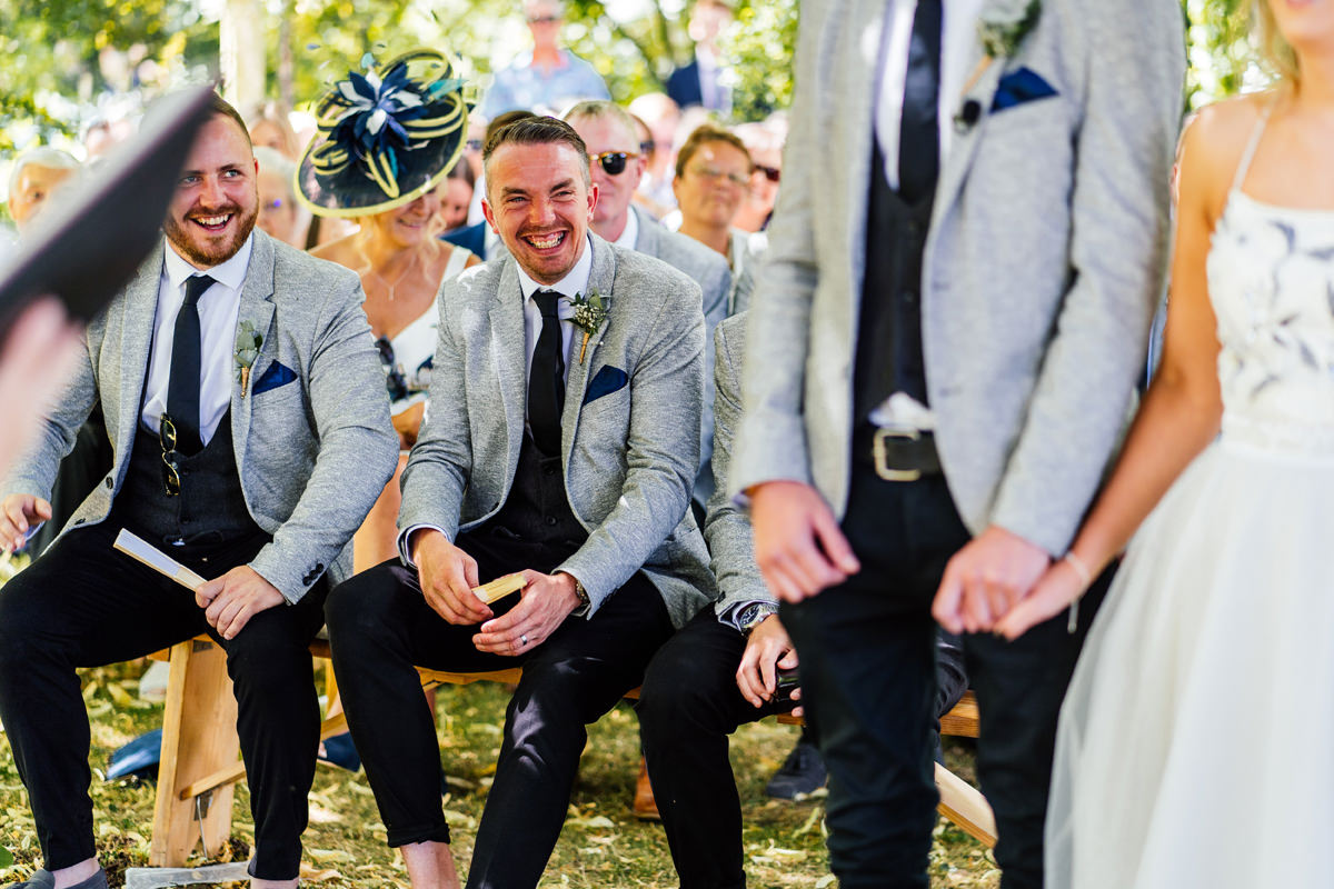 guests laughing and smiling during the outdoor ceremony