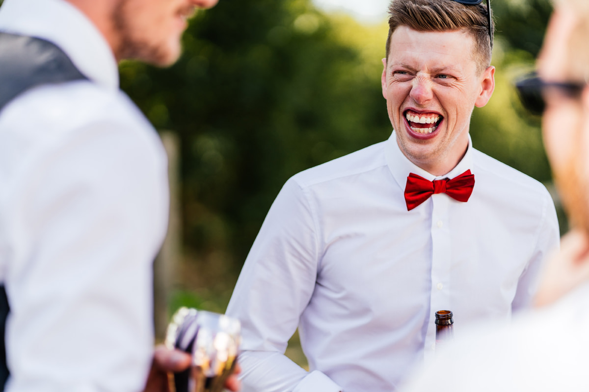 wedding guest smiling during the drinks reception