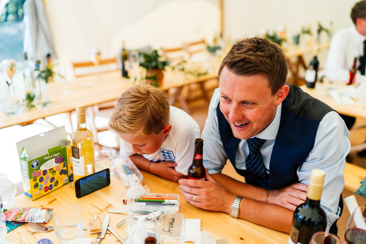 wedding guests watching world cup football on their phones