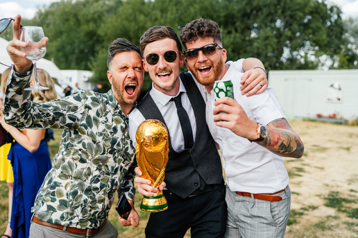 lads happy that they won the football match holding the world cup trophy