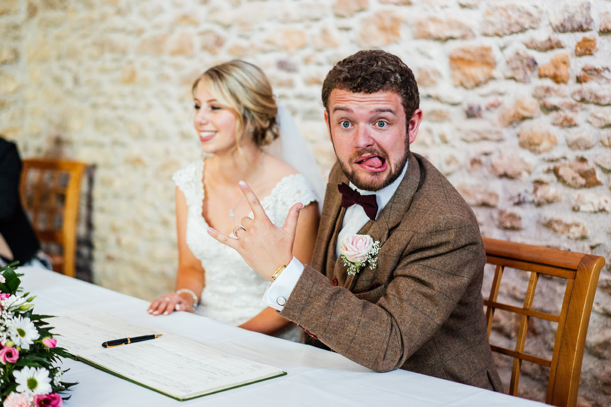 groom pulling a silly face