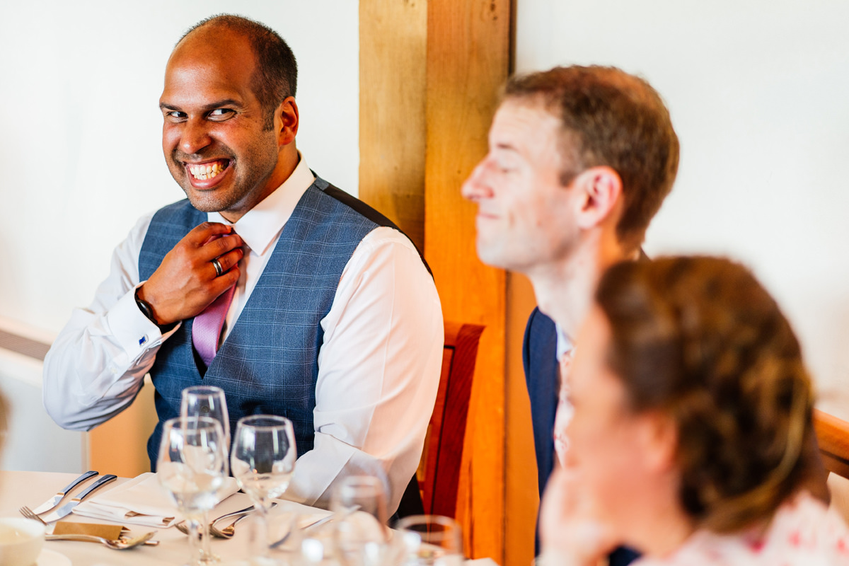 guest smiling during the wedding breakfast