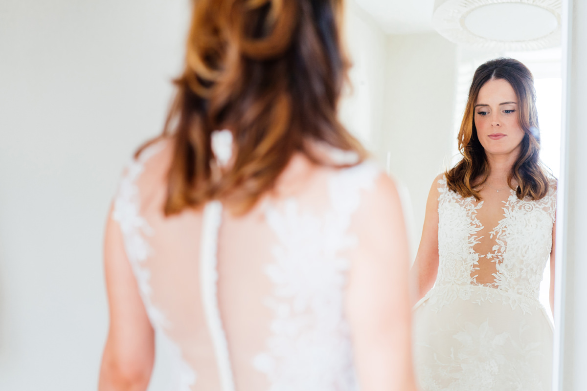 bride getting ready on morning of her wedding