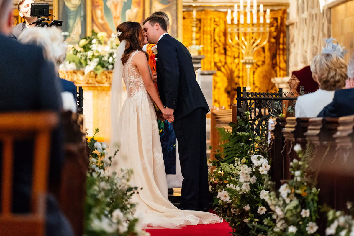 bride and groom take their first kiss