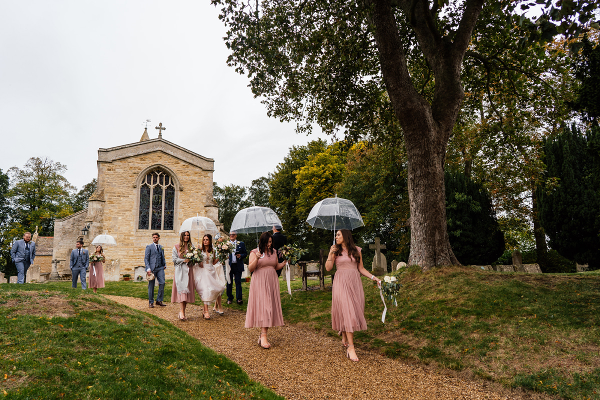 bride and bridesmaids leaving the church