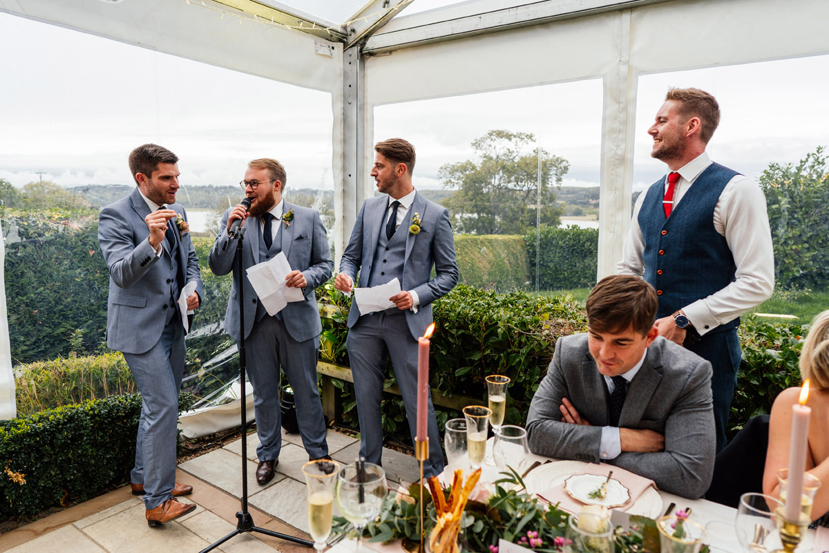 Best man give their speeches