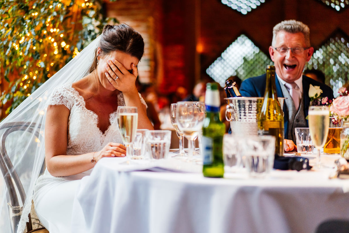 bride embarrassed during the speeches
