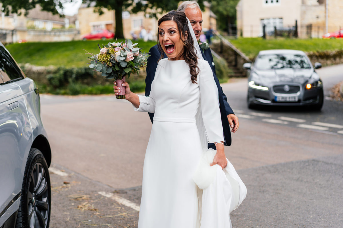 bride excited as she arrives at the church to get married