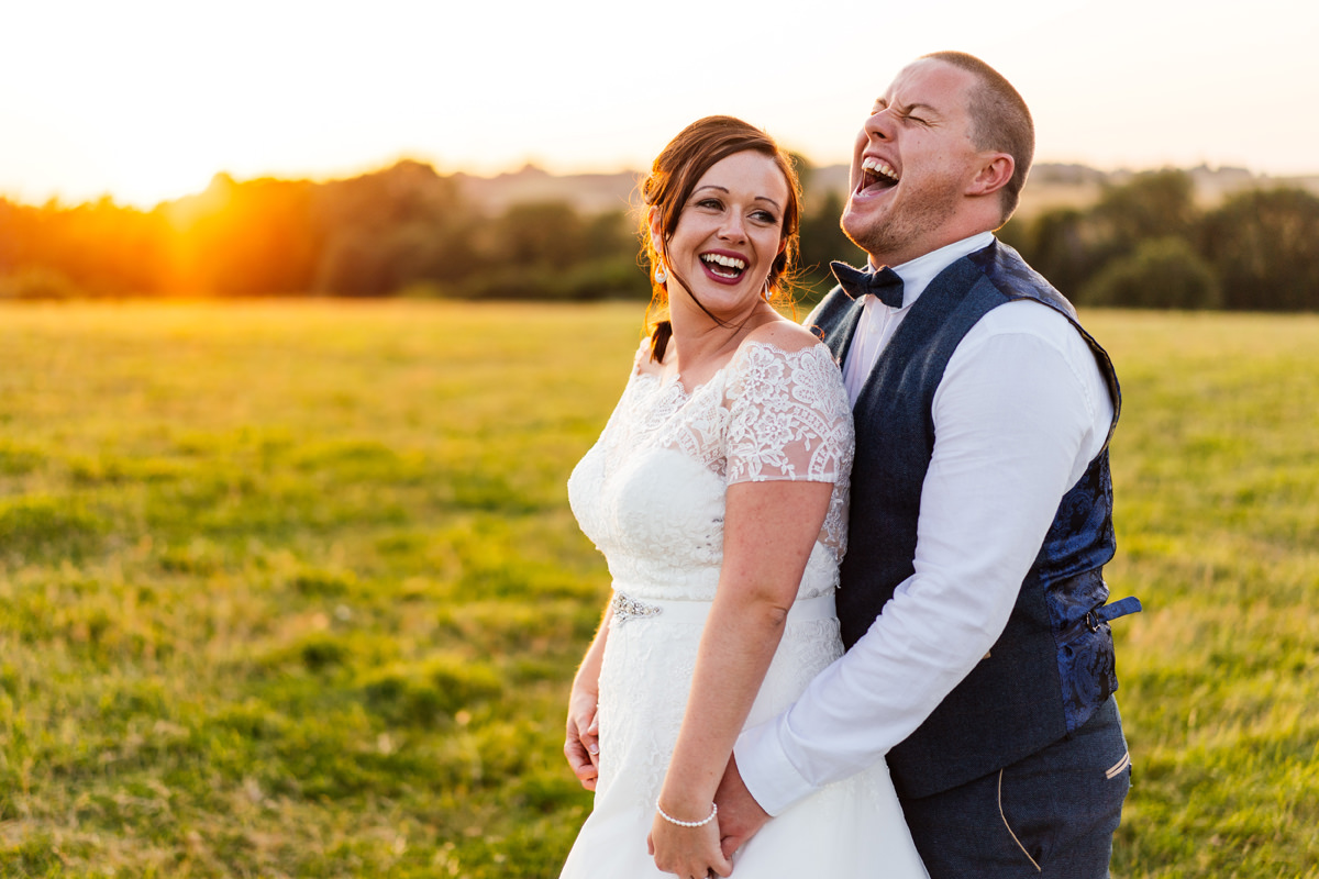 bride and groom laughing during portraits