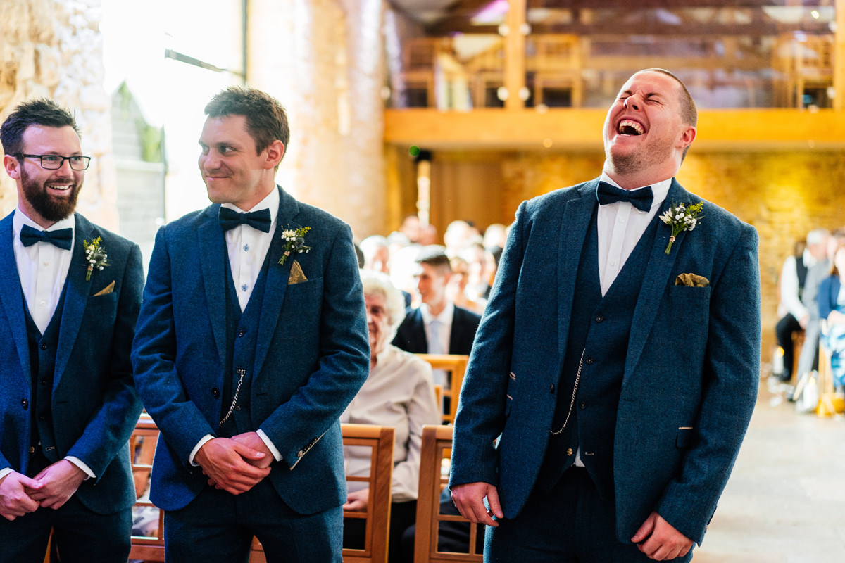 Nervous groom laughing ahead of getting married