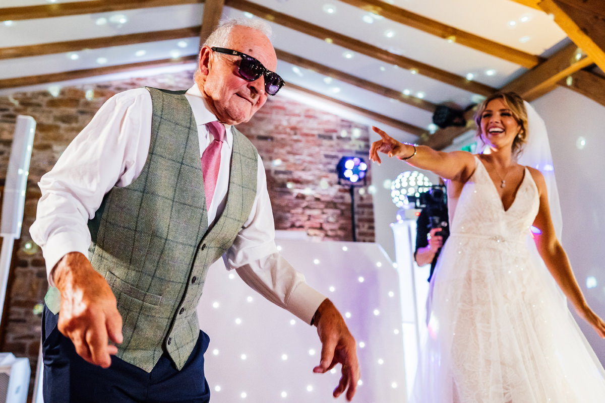 grandad rocking the dance moves with the bride