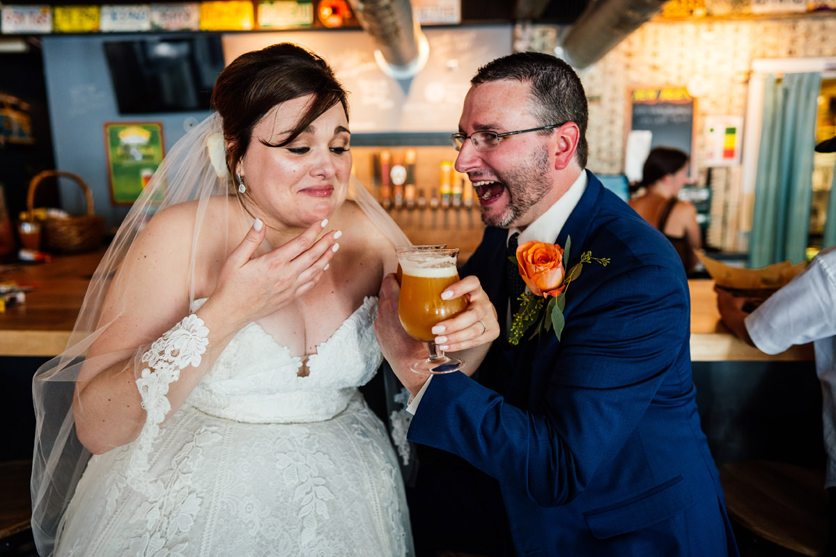 Wedding couple enjoying a pint of beer