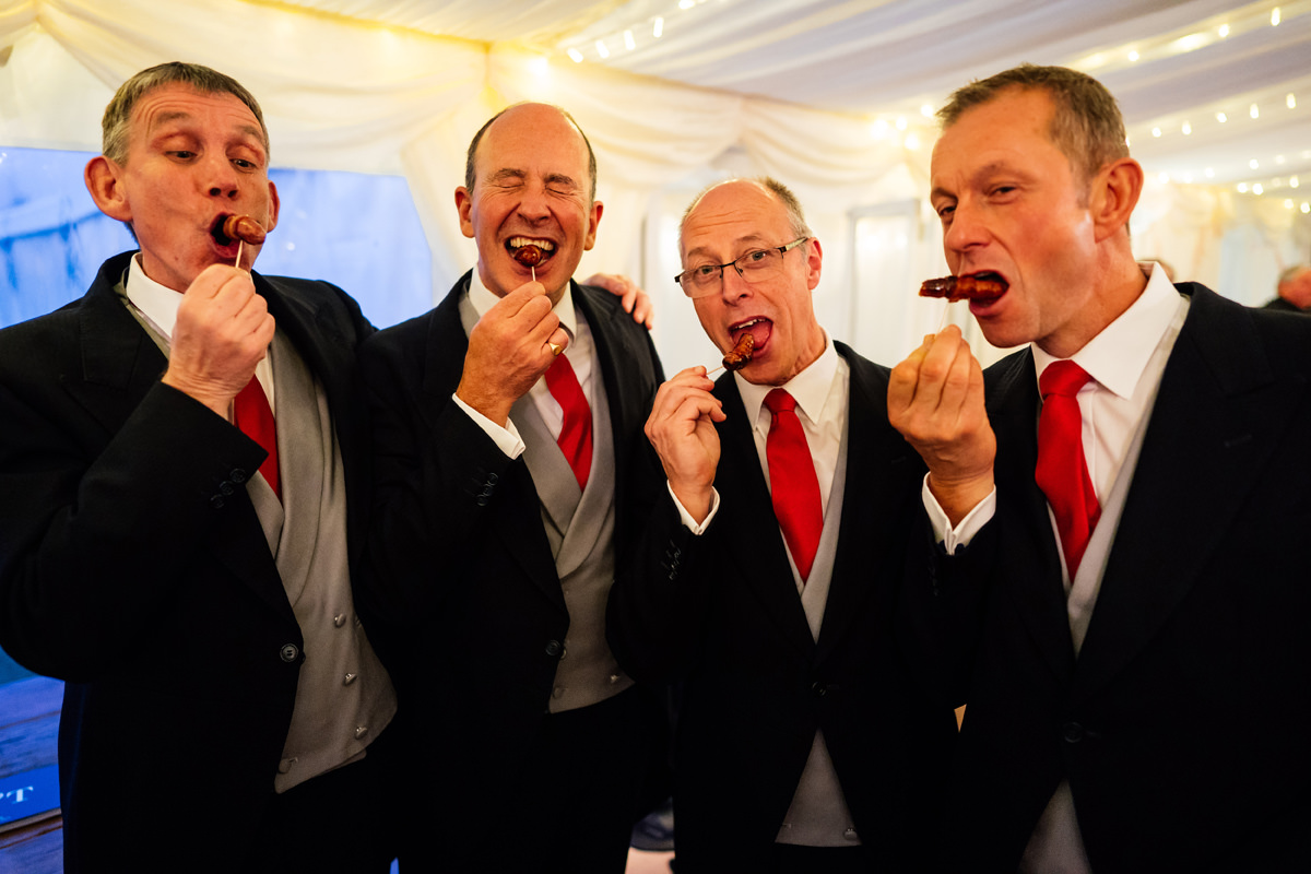 guests eating sausage canapés